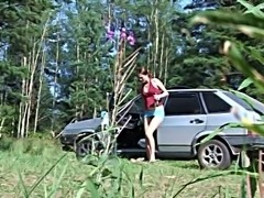 Incredible white Russian chick outdoors pissing outside the car