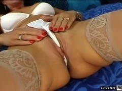 Pornstar in stockings having her hairy pussy smashed while moaning