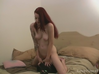 Classy redhead babe tries out the new machine