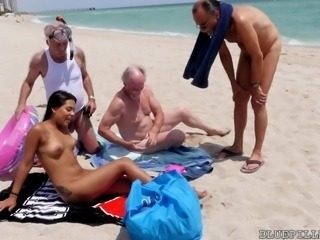 Nikki Kay was lying on the beach in her sexy bikini. She was looking for...