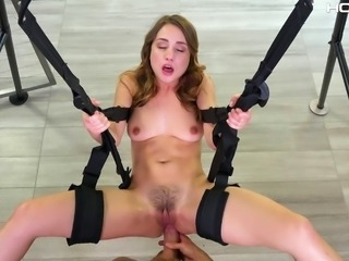 Her eyes rolling from pleasure while she's being fucked on a sex swing