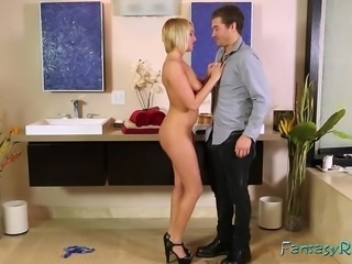 A blonde massages a lucky guy and he moves on to fuck an ebony in the jacuzzi