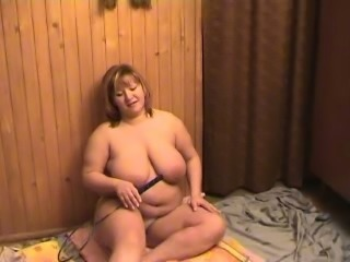 Kinky white BBW busty lady undresses and teases on cam