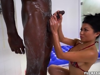 sexy asian milf lathers up his huge black penis