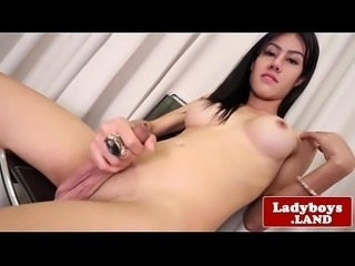 Finelooking busty Thai trans solo beating off