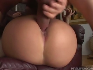 Bootyful dark haired sex doll Briana Devil gets backed over the leather sofa...