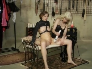 In the sex dungeon the blonde mistress is queen. The slave is there for pleasure and to have her pussy played with. When the hitachi is pressed against the slave's pussy, she moans and scream with pleasure. Soon she will cum hard.