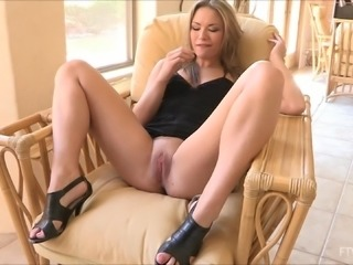 Carolyn plays with her pink pussy in high heels