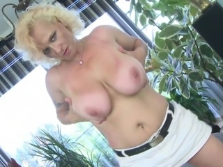 Blonde stripping while displaying her big tits in amateur mature shoot