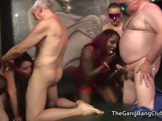 Three women at an amateur orgy are used by a group of older men