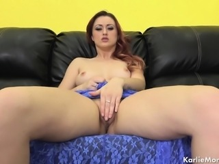 Elegant redhead with a divine ass uses her fingers to reach her climax