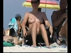 Stunning shiny smooth milf on the nnude beach captivating