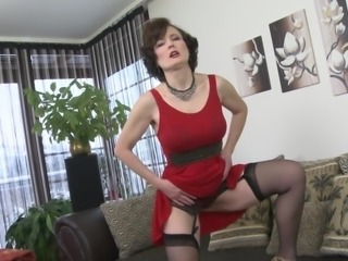 The mature brunette was horny and her husband was in office. She decided to satisfy herself and started fingering her pink pussy. She groped her boobs and loud moans automatically escaped from her mouth. Original mature solo session!!!