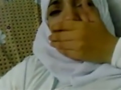 Muslin girl in hijan playing with her boobs and pussy