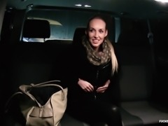 Hot action in a car between a good-looking blonde and a businessman