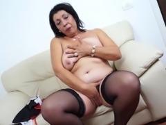 Chubby senorita in black stockings thinks about cocks and masturbates