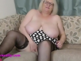 Pink high heels mature playing on the couch