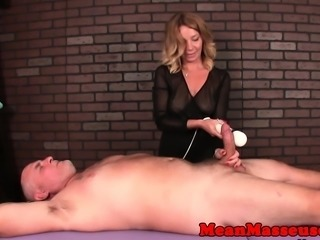 Busty mature masseuse rubs cock with vibrator
