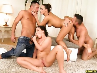 Brunette Mea Melone exposes assets while getting her love box tongue fucked by Renato in lesbian action