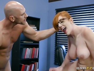 Johnny Sins is one hard-dicked guy who loves oral sex with Redhead with...