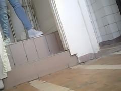 Lovely amateur lady in blue jeans filmed in the public restroom