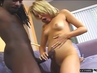 Charming blonde getting rough face fucking in interracial porn