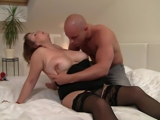 A chubby MILF with huge tits gets on top of a younger guy