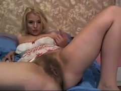 Auburn lady exposed her too hairy pussy and tickled her clit a bit