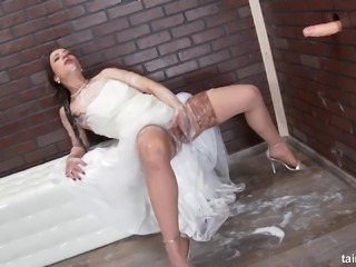 Woman in a wedding dress has a blast with a dick from a hole