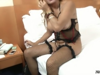 Trashy looking ladyboy in stockings Yenny shows penis and takes a shower