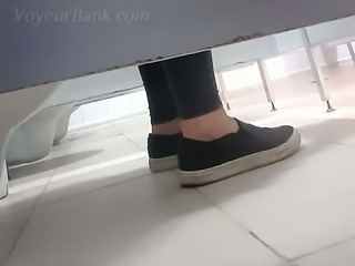 White amateur teen in black panties and sneakers filmed in the toilet