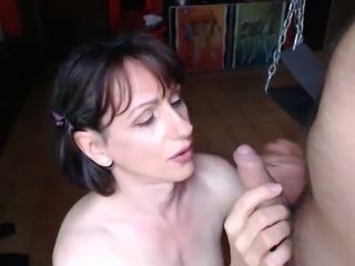 Brunette girl sucking hard cock balls deep in amateur video