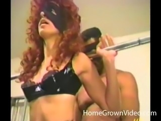 Blindfolded hunk enjoys a skillful redhead's hot body