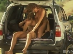Sweet black haired hooker Venus fucks with her BF in the car trunk
