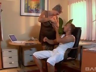 Elderly woman in black lingerie spreads her legs for a stiff dick