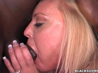 Multiple hot black studs use this sexy blonde as a sexual plaything. They...