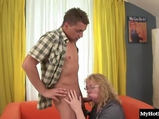 Granny slurps on a delicious cock and rides it like a cowgirl