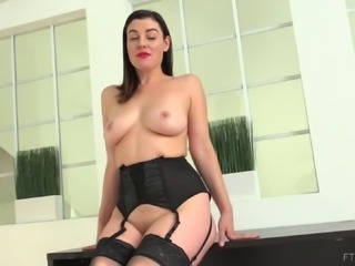 Her sexy black lingerie is quite revealing and she is flaming hot