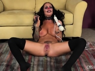 Lustful tattooed clown with big boobs Brandy drives herself to climax