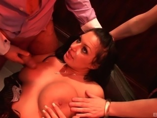 Busty chick joins a kinky guy and an insatiable brunette for a fuck
