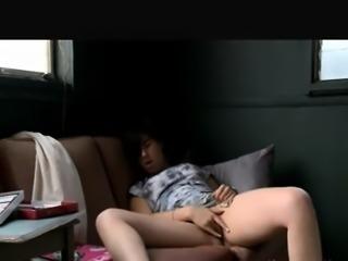 Brunette having extreme solo program on her sofa