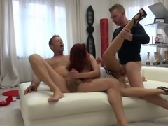 Fine redhead Hungarian bimbo shows her goodies and gets into threesome action