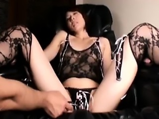 Sexy slender Japanese lady drops her clothes and sits on a