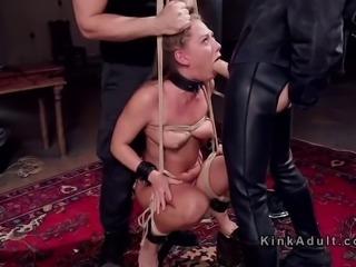 Blonde in suspension bondage gagged
