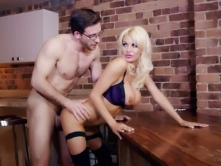 Busty cock-worshiping blonde fucked by a guy with glasses