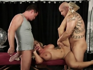 Hot masseuse Cali Carter banged by two handsome men