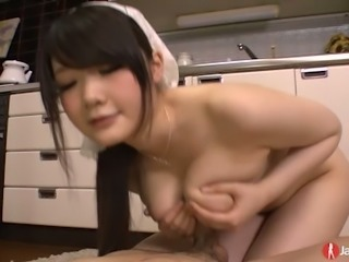 Tasty looking Asian housewife with big melons Rie Tachikawa gives head to her stud at kitchen