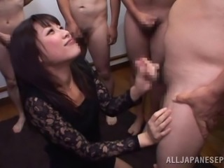 Enticing Asian MILF giving a sensual handjob in gangbang before being smashed doggystyle
