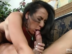 hot mommy takes his balls in her mouth