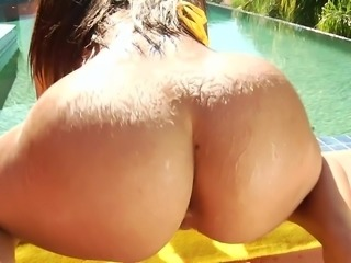 Her big wet booty glistens, as water is splashed all over it. The hunk licked her ass and twat, before ramming his cock deep inside of her, and ramming her from behind. Her thick bum jiggles and shakes, as she is fucked.